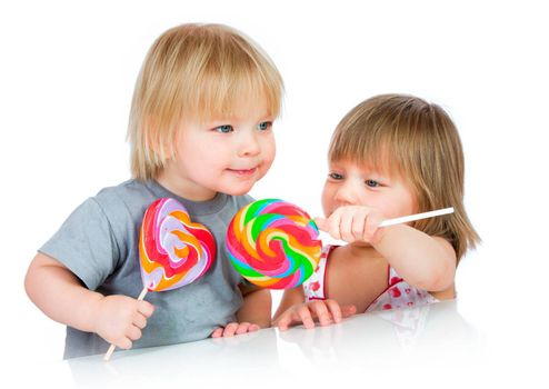 Babies eating a sticky lollipop isolated on white background.