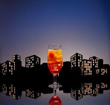 Metropolis Tequila Sunrise cocktail in city skyline setting