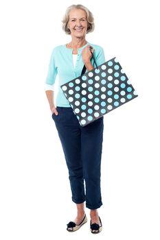 Charming senior lady with shopping bag