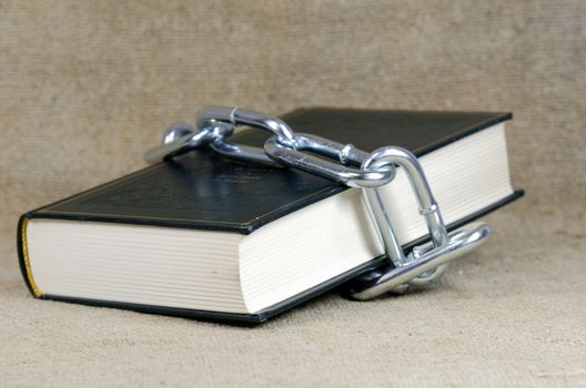 book surrounded with chain