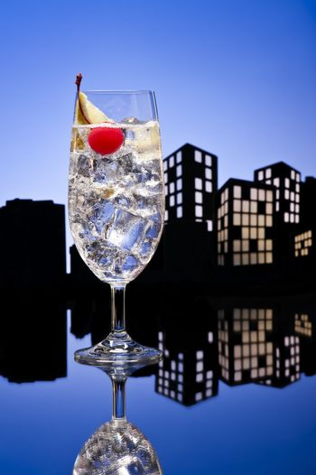 Metropolis tom collins or Gin Tonic cocktail cocktail in city skyline setting