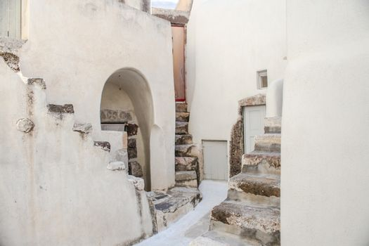 Village houses with old staircases in greek village at Santorini island