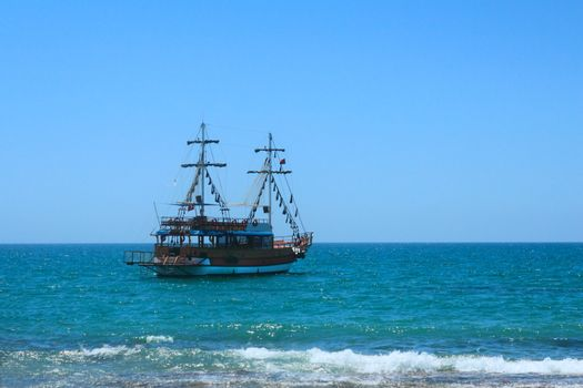 A small sailing vessel for sea trips near beach resort
