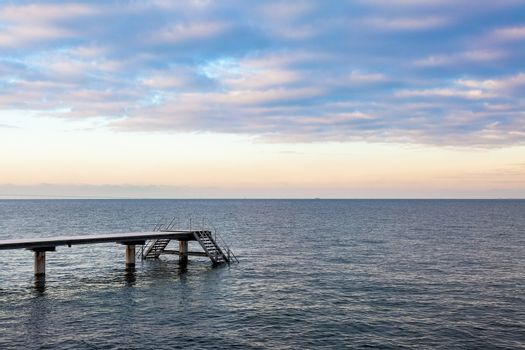 Boat pier at Øresund with a beautiful sunset sky. Malmo, Sweden
