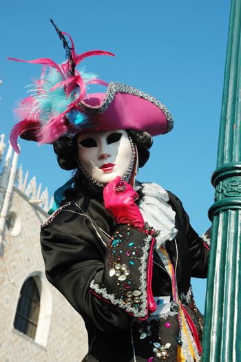 Lady in costume at St. Mark's Square during the Carnival of Venice