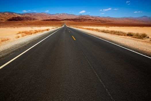 Death Valley straight road in desert National Park