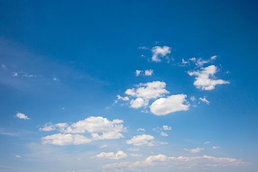 Photo of a beautiful blue sky with white clouds.