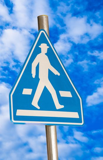 pedestrian blue traffic sign isolated on sky background