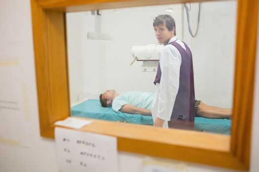 View of practitioner doing a radiography through a window