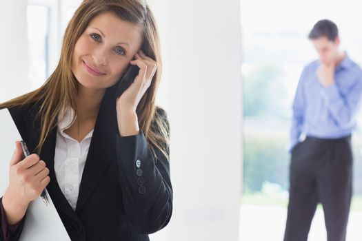 Estate agent on the phone with man deciding