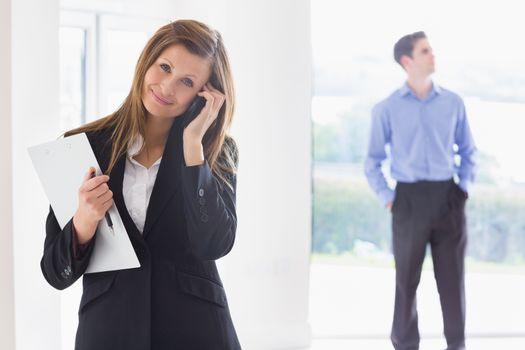 Estate agent on phone while man deciding