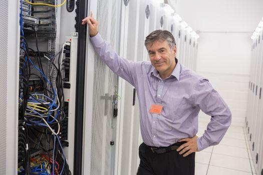 Technician leaning against server