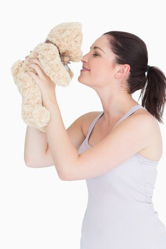 Woman with her teddy bear