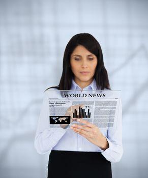Businesswoman scrolling through virtual newspaper
