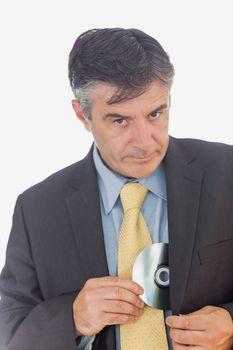 Businessman stealing compact disk