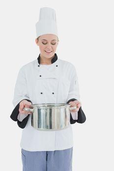 Happy chef holding utensil
