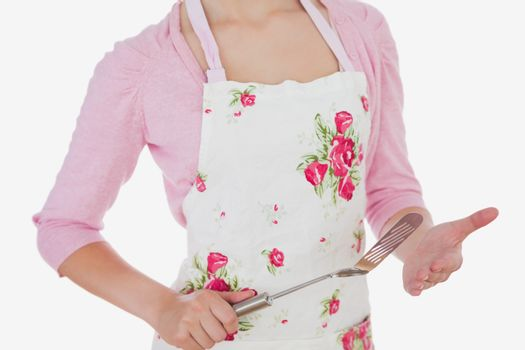 Woman in apron holding spatula