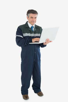 Mature repairman with laptop