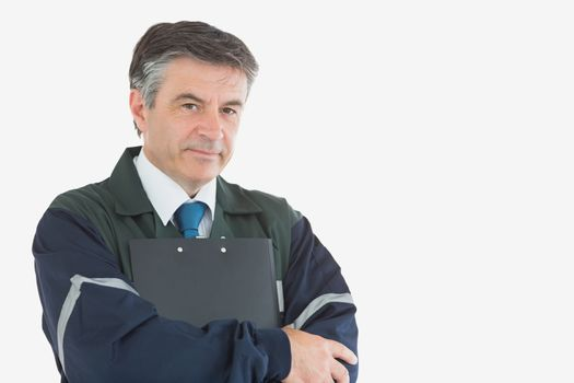 Handsome repairman with clipboard
