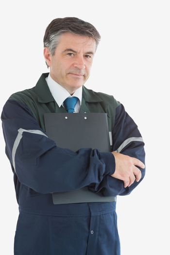 Confident repairman with clipboard