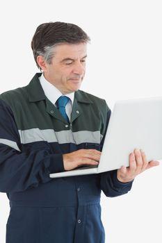 Repairman using laptop