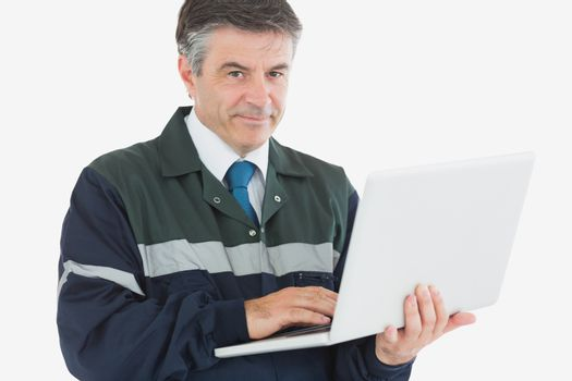 Handsome repairman with laptop