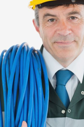 Repairman with rolled cable