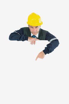 Repairman pointing at billboard