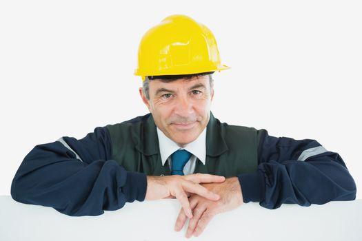 Repairman leaning on billboard