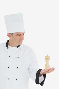 Chef holding salt shaker