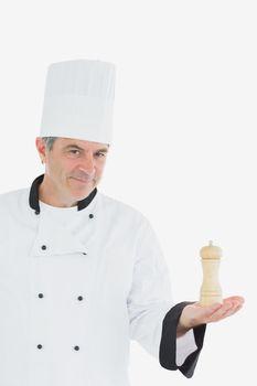 Confident chef holding salt shaker