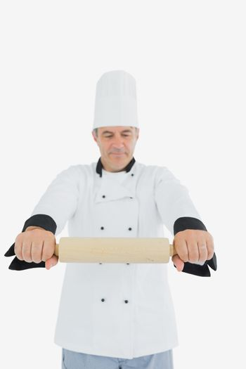 Chef holding out rolling pin