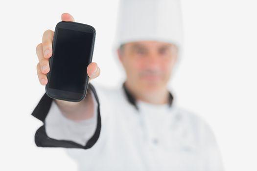 Chef displaying smartphone