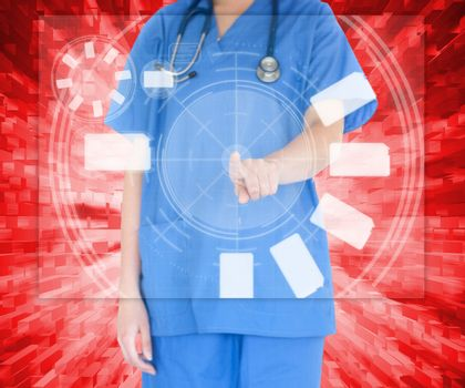 Woman in scrubs standing against a red background