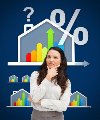 Thinking businesswoman standing against a energy efficient house graphic