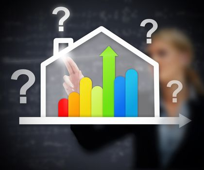 Businesswoman working with energy efficient house graphic with question marks