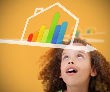 Girl looking up to energy efficient house graphic