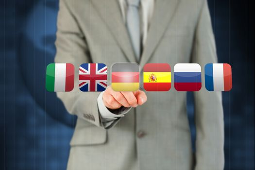 Businessman activating German flag on touchscreen