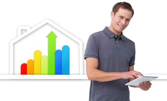 Man using tablet against energy efficient house graphic