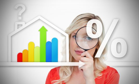 Woman standing behind energy efficient house graphic with question and percentage marks