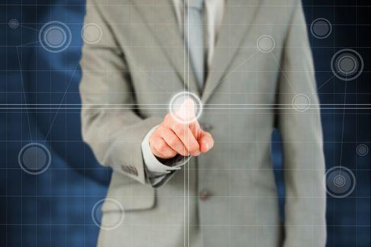 Businessmans finger activating futuristic touchscreen