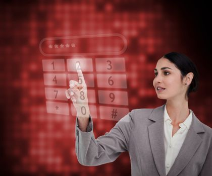 Businesswoman standing against a red background