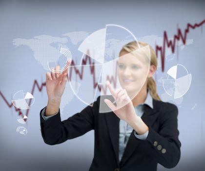 Businesswoman touching graphs
