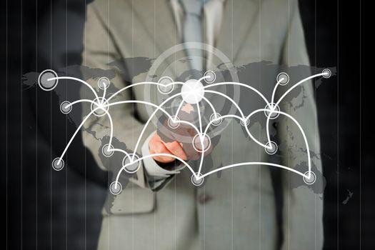 Businessman activating futuristic touchscreen