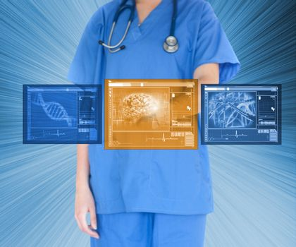 Doctor using touchscreen against blue background