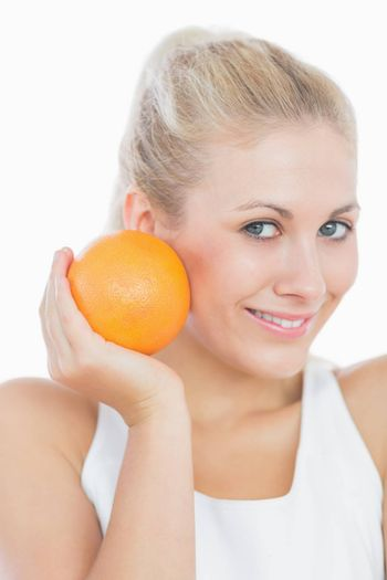 Happy young woman with orange