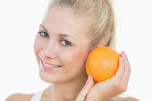 Happy woman with fresh orange