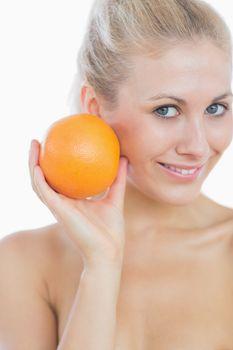 Happy woman holding fresh orange