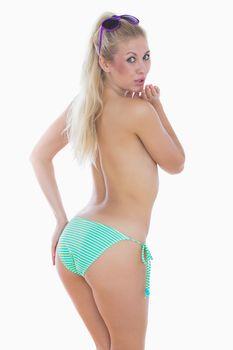 Topless woman in bikini bottom looking at you