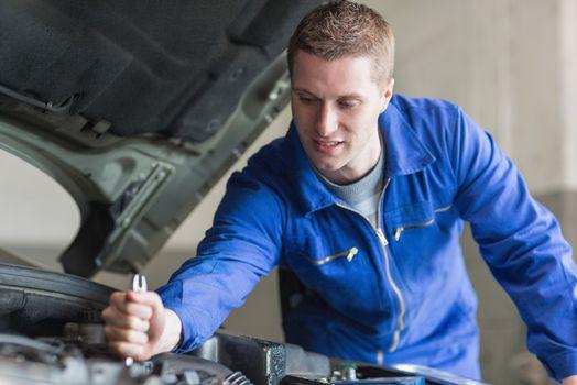 Mechanic working on automobile engine